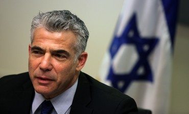 Yesh Atid leader Yair Lapid at a faction meeting, February 18, 2013.