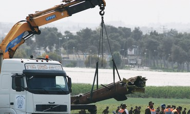 A CRANE lifts the tail section of the helicopter that crashedin a field near Kibbutz Revadim