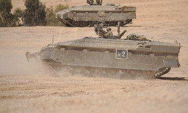 A NAMER APC take part in a live-fire exercise in the Negev.