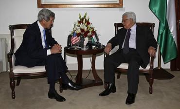 Palestinian President Mahmoud Abbas (R) meets with U.S. Secretary of State John Kerry in Ramallah