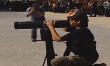 Gaza schoolboy firing rocket launcher.