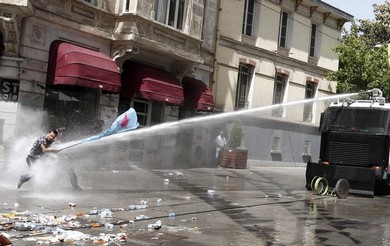 Riot police use a water canon to restrain a protester during an anti-government protest at Taksim Square in central Istanbul June 1, 2013 (Reuters)