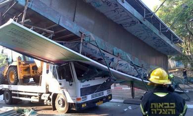 Bridge collapses on truck in Kfar Saba (Courtesy MDA)
