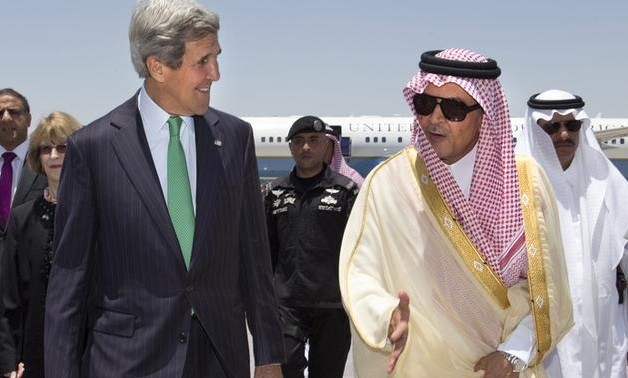 US Secretary of State Kerry greeted by Saudi Arabia's FM Prince Saud al-Faisal, June 25, 2013.