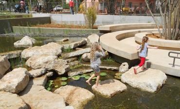 Children crossing the stepping stones (Ram Eisenberg)