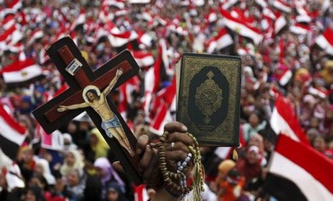 A cross and a Koran at an anti-Morsi protest in Tahrir Square, July 4, 2013.