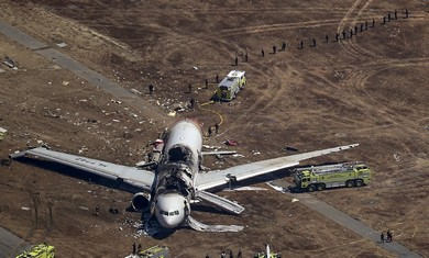 Search and rescue officials surround an Asiana Airlines plane after it crashed in San Francisco (Reuters)