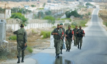 PALESTINIAN SECURITY forces loyal to Hamas patrol the border area between Egypt and southern Gaza.