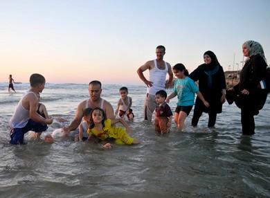 A family celebrates Id al-Fitr at the beach in Tel Aviv (Hadas Parush)