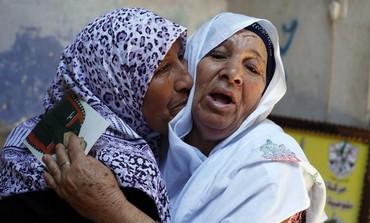 Madre de preso palestino reacciona después de escuchar las noticias sobre la posible liberación de su hijo, julio de 2013.