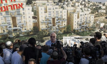 Housing Minister Uri Ariel speaks to reporters at a ceremony announcing construction in east J'lem.
