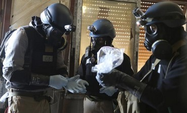 A UN team examining samples from site of August 21 attack in Damascus. Photo: REUTERS/Mohamed Abdullah