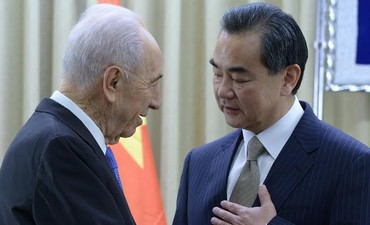 President Shimon Peres  meets with Chinese Foreign Minister Wang Yi. Photo: Mark Neiman, GPO