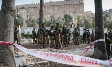 Soldiers stand outside of Cave of Patriarchs in Hebron