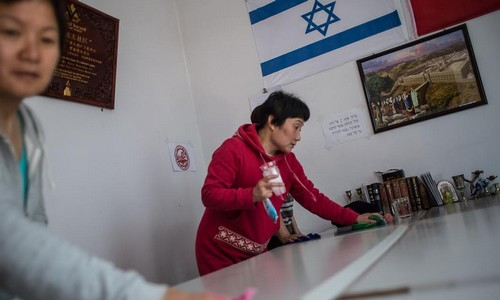 Cleaning the Jewish center in Kaifeng before the holday.