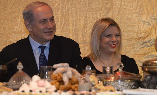 Prime Minister Binyamin Netanyahu and his wife Sara at a Mimouna celebration in Or Akiva. (Mark Neiman/GPO)