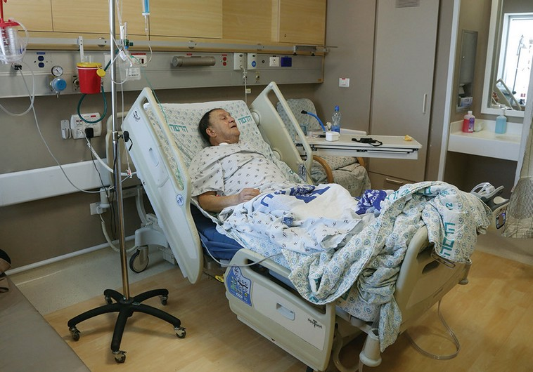 Man lying in a hospital bed at Hadassah University Medical Center in ...