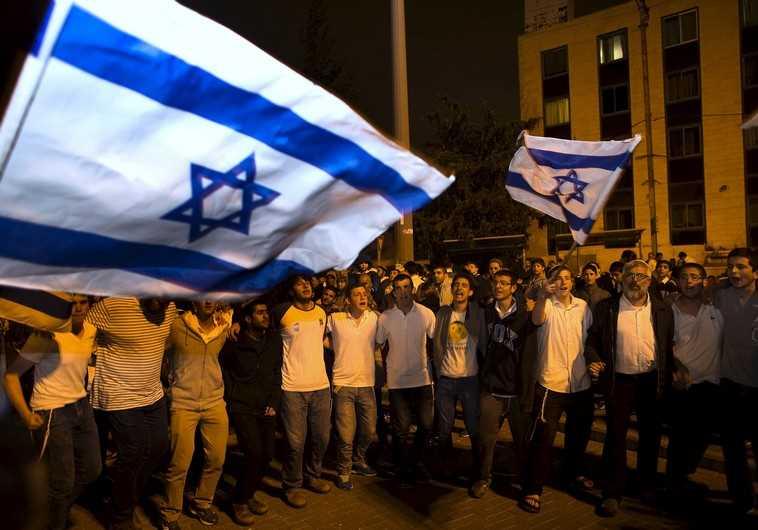 Israelis dancing with flag in Jerusalem