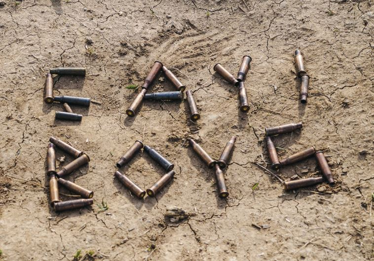 'CHAI BOYS' in Kurdish, written out in bullets in a photo taken by 'Ariel' on his phone. (Courtesy Robert Amos)