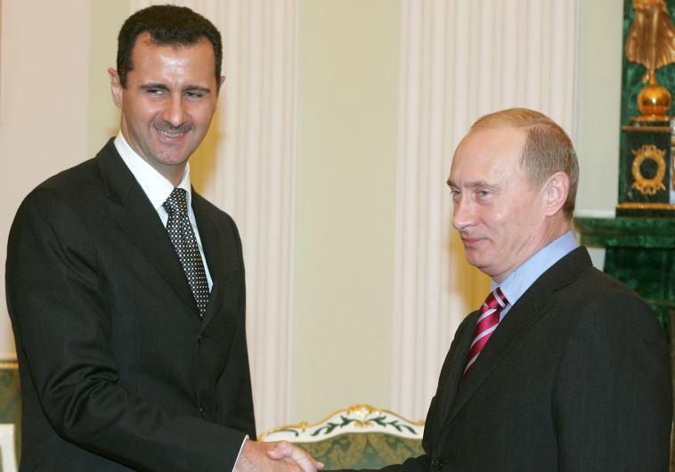 Syrian President Bashar Assad (L) shakes hands with his Russian counterpart Vladimir Putin.