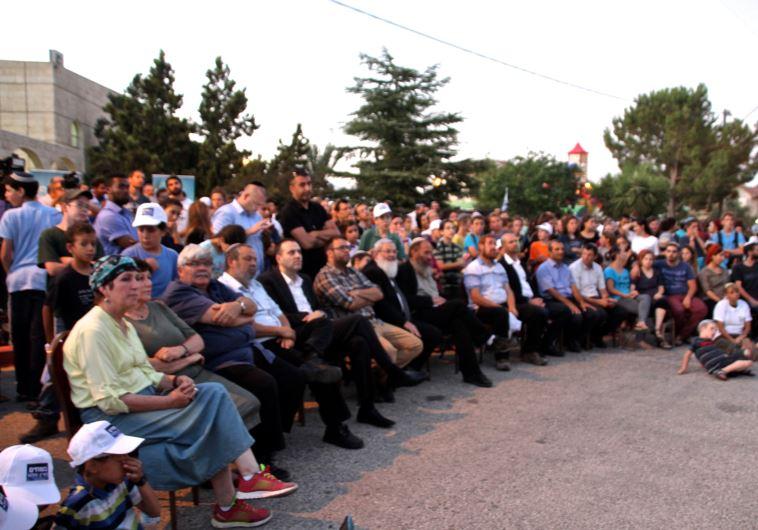 Settlers, Likud politians at Otniel rally on Sunday night.