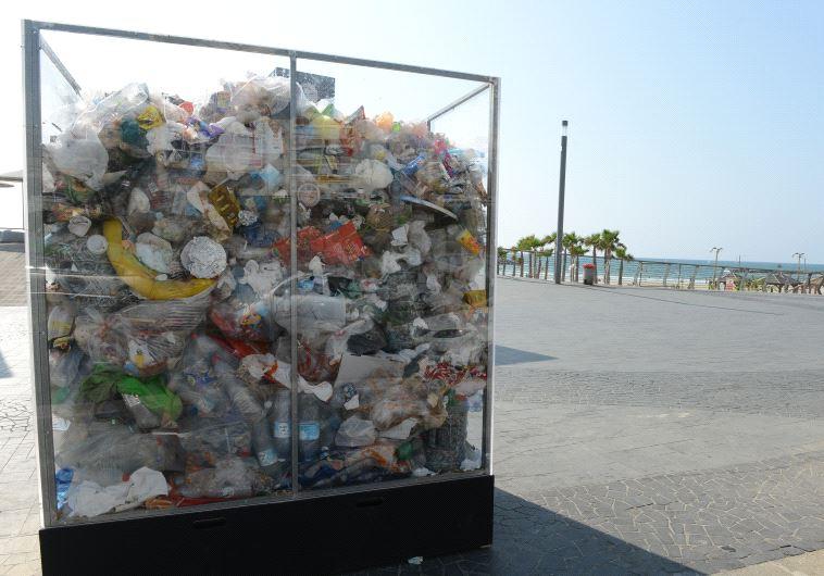 Transparent trash cube on Tel Aviv beach front (Tel Aviv - Yafo Municipality)