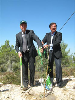 President of German States Council of Education Ministers Plants Tree at Kennedy Memorial