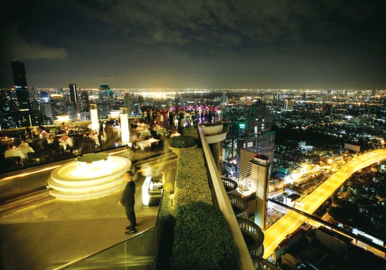 The Sky Bar rooftop offers panoramic views of the Bangkok skyline at night (photo credit: GUY YECHIELY)
