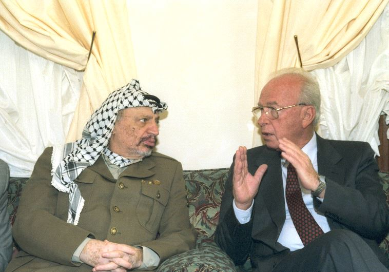 Prime Minister Yitzhak Rabin meets with PLO chairman Yasser Arafat in Casablanca on October 30, 1994 (photo credit: SA'AR YA'ACOV/GPO)