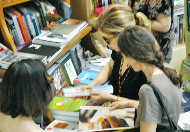 Shoppers in the Sipur Pashut book store in the Neveh Tzedek neighborhood in Tel Aviv (photo credit: SHIRA LEVY AND GRANTA)