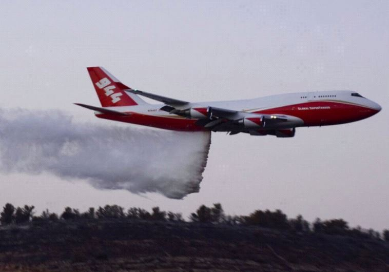 The Supertanker in action.(photo credit: POLICE SPOKESPERSON'S UNIT)