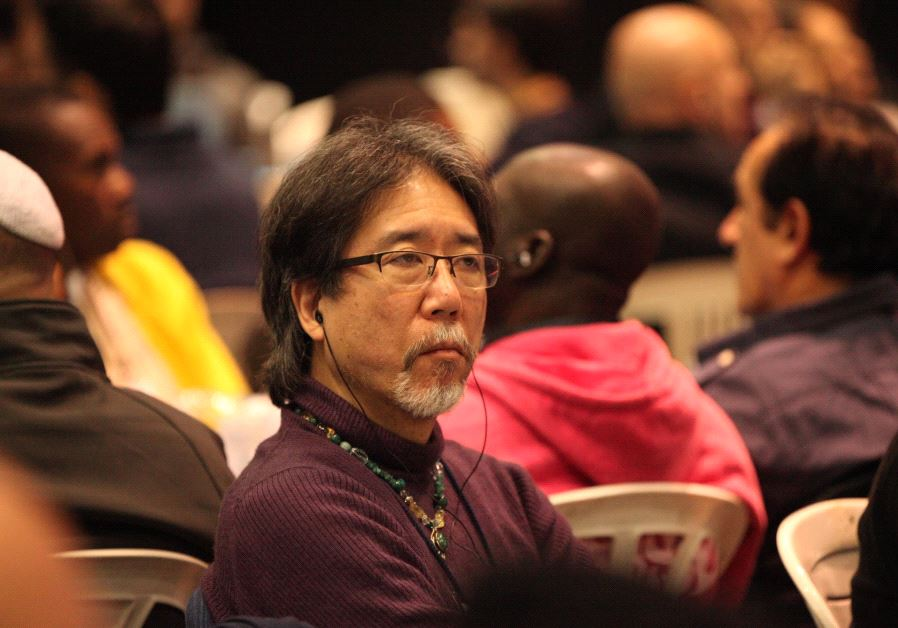 A participant from Japan focusing during a lesson at the 2016 World Kabbalah Convention. (photo credit: ASHER BITON)