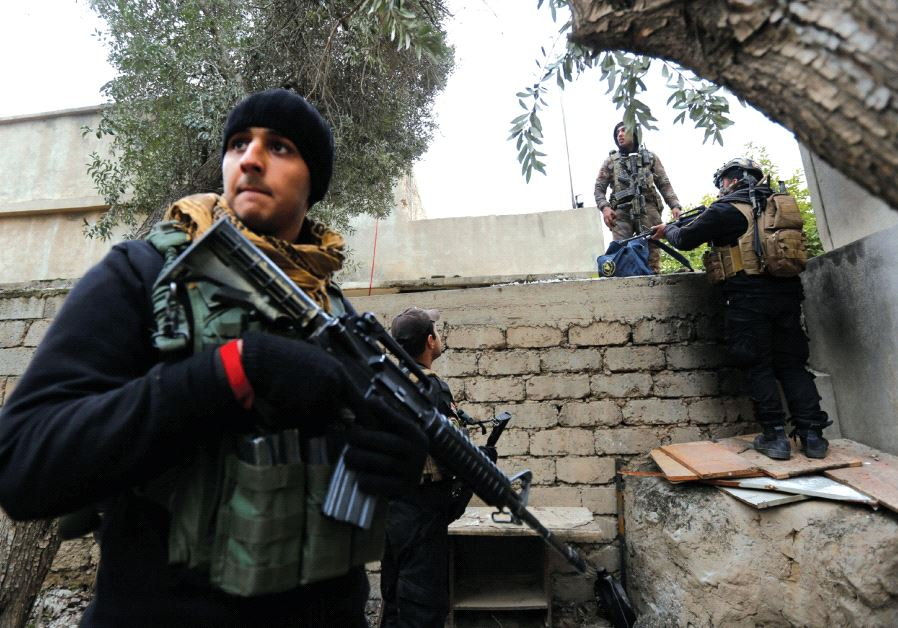 ISOF troops conduct a search of a house near the university, January 15 (photo credit: REUTERS)