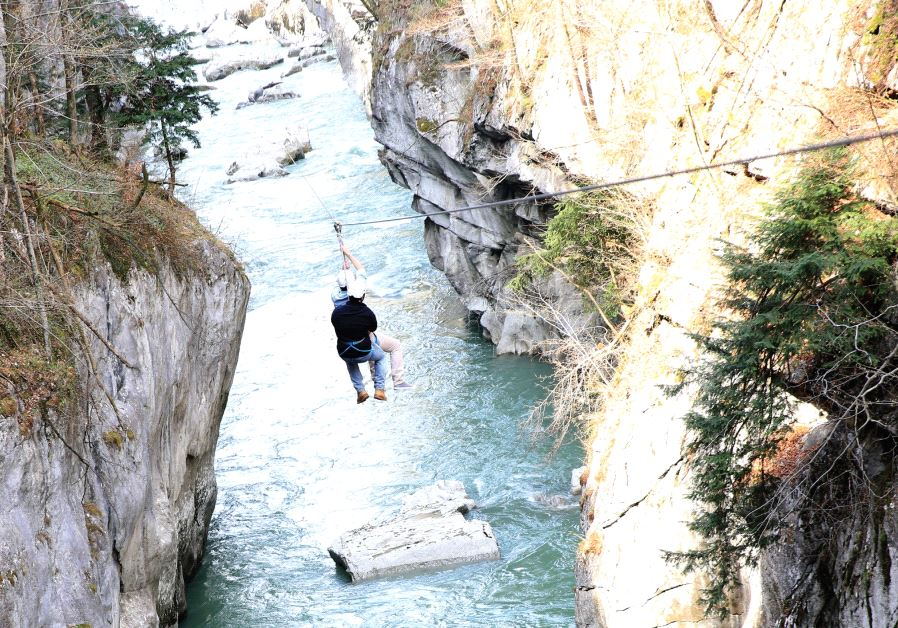 Speeding down the 900-meter Flying Fox zip-line suspended high above the River Salzach (Liron Almog)