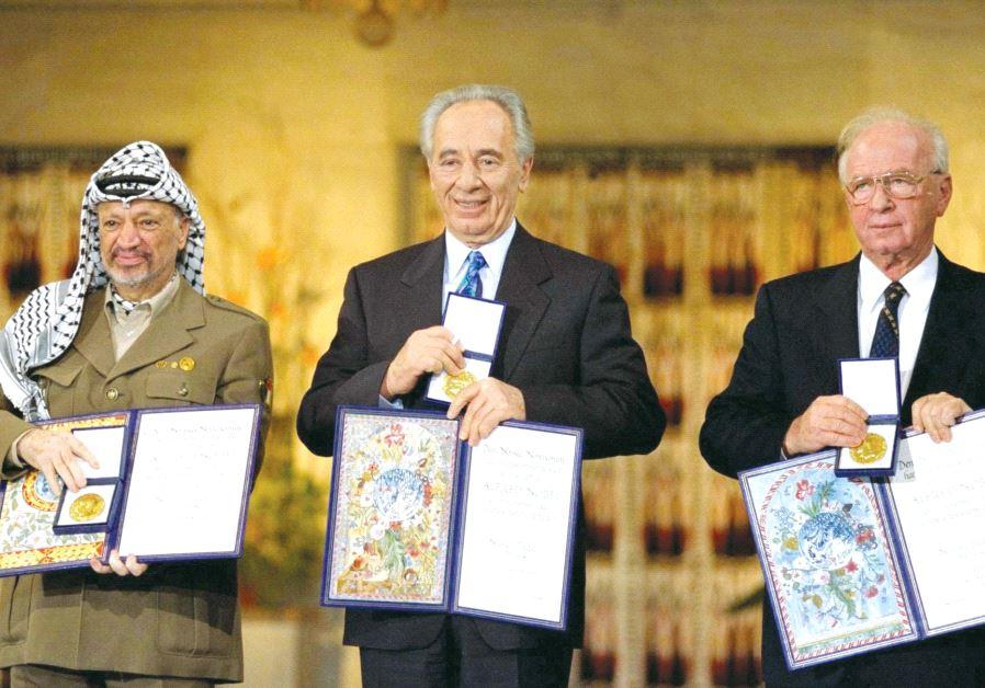 PERES receives the Nobel Peace Prize in Oslo, Norway, in 1994 alongside Yitzhak Rabin and Yasser Arafat. (GPO)