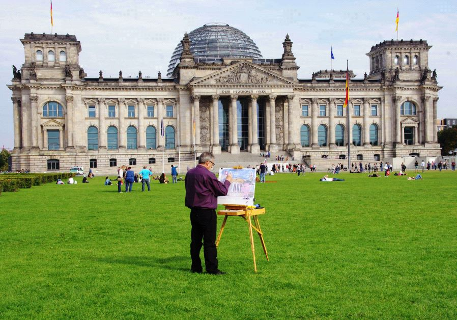 Philippe Mora painting at the Reichstag in Berlin, Germany (credit: COURTESY)