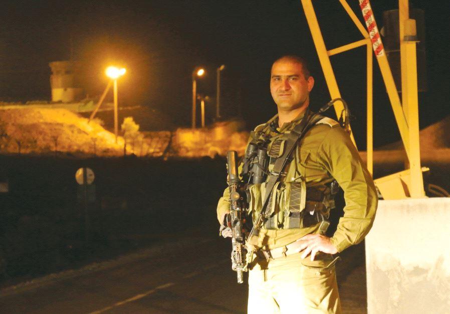 Major Alem Saad of the Caracal unit stands next to the border fence (credit: Seth J. Frantzman)