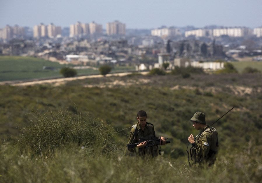 IDF soldiers near Gaza border (Reuters)