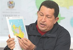 Chavez points to a map of the Venezuelan-Colombian