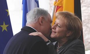 Netanyahu embraces Merkel, Monday.