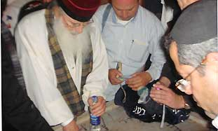 Pilgrims at grave of Rabbi Abuhatzeira in Egypt