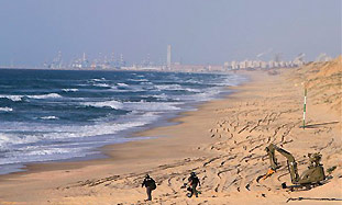 Police sappers scan Ashkelon's Hofit beach, Monday