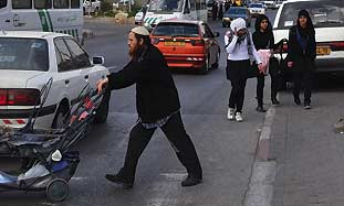A Jew and Arab girls cross paths in Sheikh Jarrah.