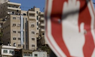 An Israeli flag is seen running down the facade of