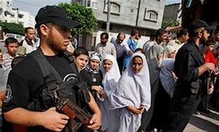 Hamas bodyguards wait to escort Haniyeh in Gaza.