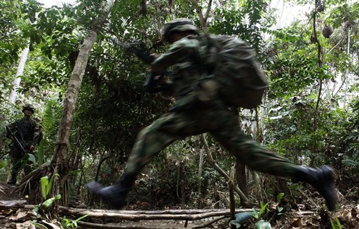 A soldier jumps during a military operation to sec