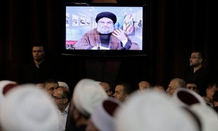 Hezbollah leader Hassan Nasrallah speaks through a