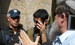 National Union MK Ya'acov Katz, right, asks police