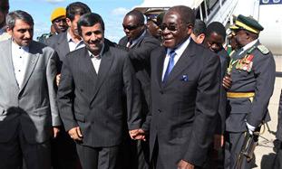 mugabe ahmadinejad hold hands