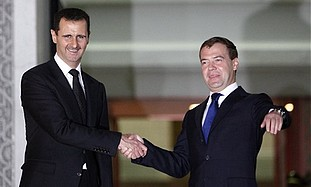 Medvedev and Assad shake hands upon their arrival